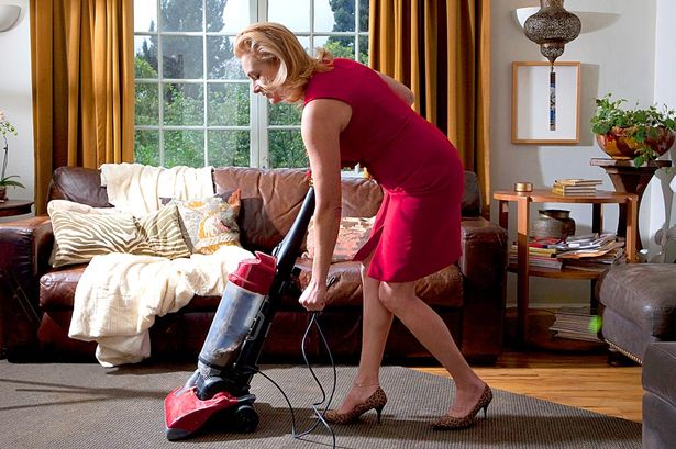 Woman-vacuuming