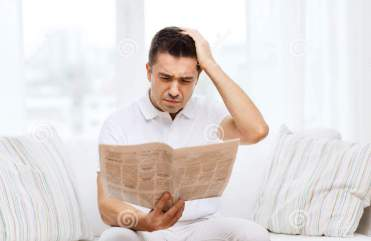 sad-man-reading-newspaper-home-leisure-information-people-mass-media-concept-60761214